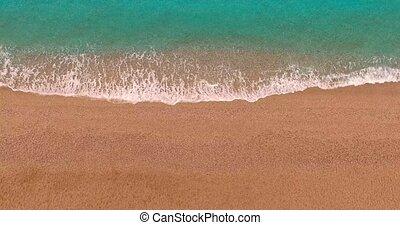Sea waves and seashore - Top view of seashore. Waves of blue...