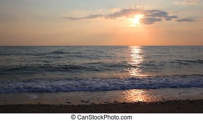 sea waves are rolled on empty coast at summer daybreak