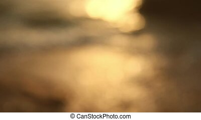 Sea waves blurred background - Sea waves at sunrise with sun...