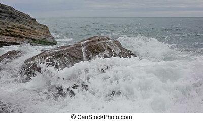 Sea waves break about the coast, Laguria, Italy