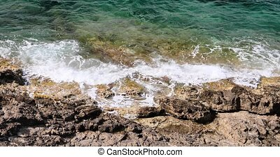 Sea waves break about the rocky coas, the cape Ferrat of ...