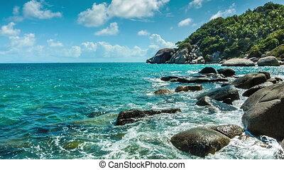 Sea waves breaking on the rocks