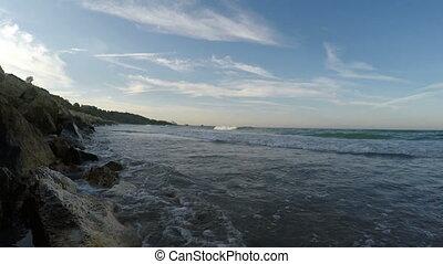 Sea waves breaking