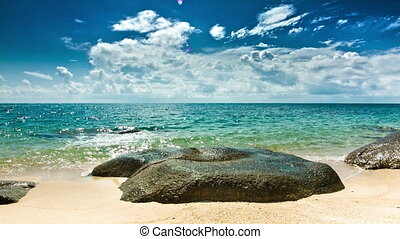 Sea waves breaking on the stone on the beach