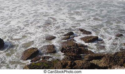 sea waves crashing against the rocks, morocoo