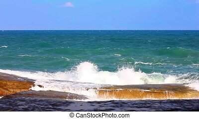 Sea waves crashing in spray on the rocky coast