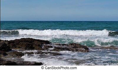 Sea waves crashing in the spray