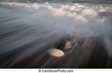 Sea waves crashing into the shore
