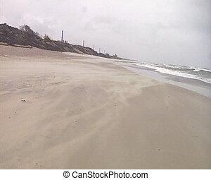 sea waves drifting sand