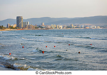 Sea waves on a warm summer day. Sunny beach.
