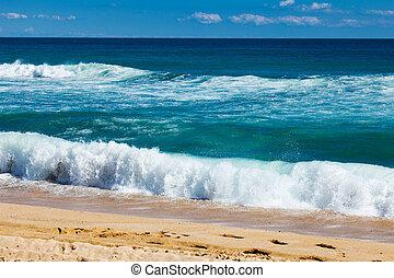 sea waves on sand beach at mediterranean in windy day
