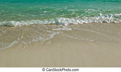 Sea waves on sand beach