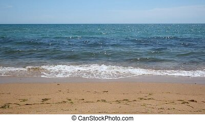 Sea waves on sandy beach
