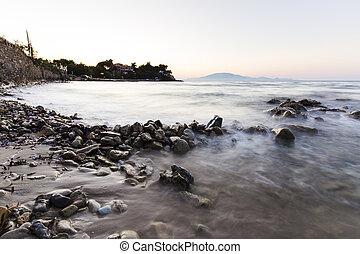 Sea waves on stone beach