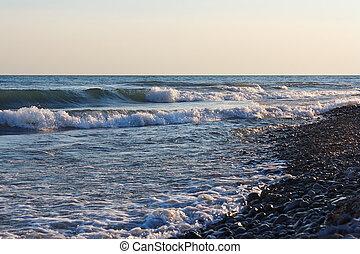 Sea waves on the beach against clear sky