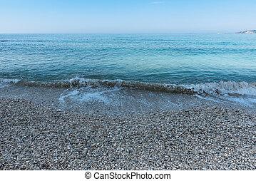 Sea waves on the pebble beach