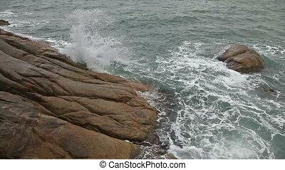 Sea waves on the rocky beach