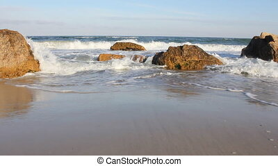 Sea waves on the rocky shoreline