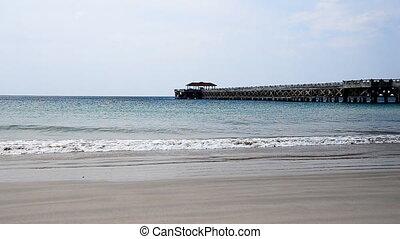 Sea Waves over Sand Beach