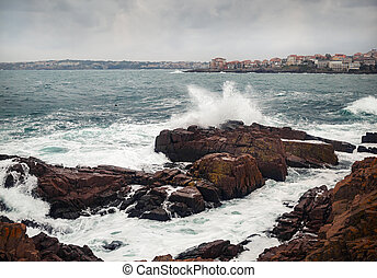 Sea waves, rocky shore
