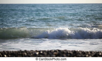Sea waves rolling on stony shore during the day - Sea waves...