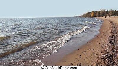 Sea waves run  on the empty beach
