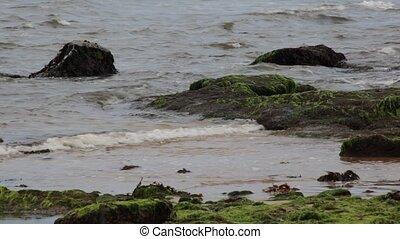 Sea waves splashing on rocks.