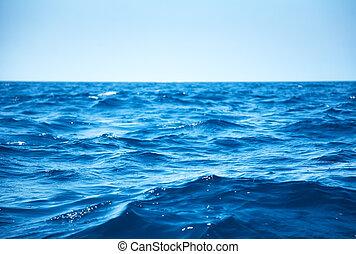 Sea waves - Blue sea waves closeup view.