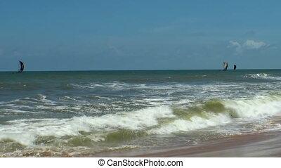 Sea waves surf on sandy beach. Maldives. Close up.