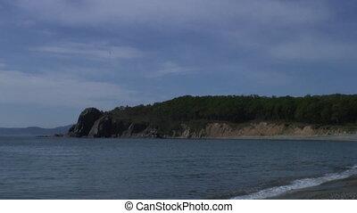 Sea waves surf on stony rocks beach. Japan Sea. Suitable for...
