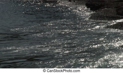 Sea waves surf on stony rocks beach. Japan Sea.