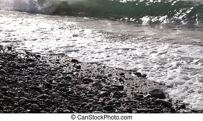 Sea waves washes pebble beach. - Sea or ocean waves washes...