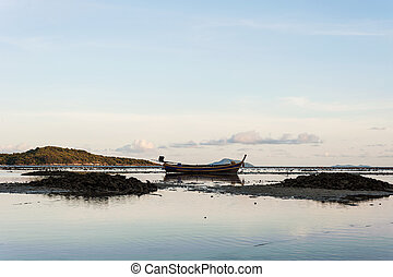 Sea with morning light and fishing boat