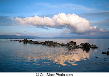 sea with reflection of the clouds