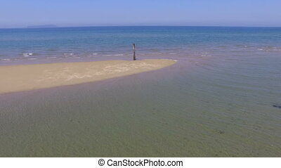 sea with sand of tideland - aerial drone flying, sea with...