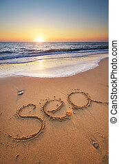 Sea word on the beach