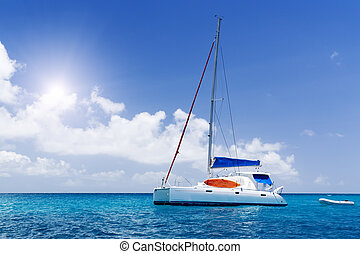 Sea yacht in azure water. Blue sky and green tropic island. ...