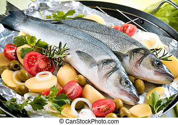 Seabass - fish with the vegetables on a grill