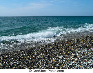 Waves on a pebbles sea beach
