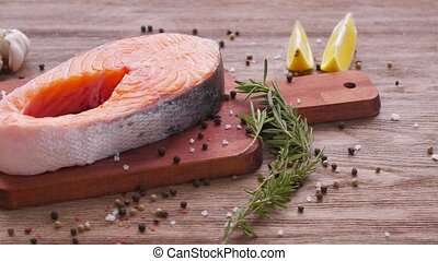Seafood and cooking concept. Fresh raw salmon steak with spices