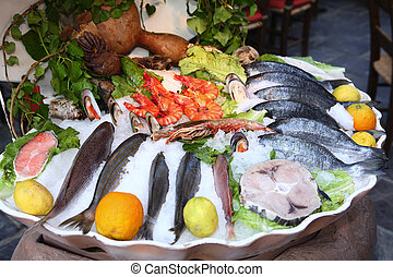 Seafood at a Greek taverna - A display of seafood on ice at ...