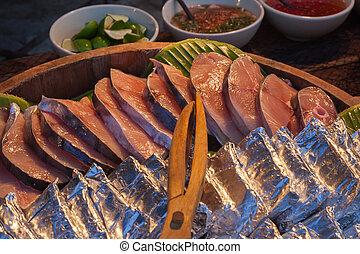 Seafood buffet line.