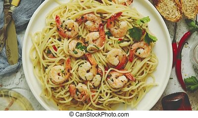 Seafood concept. Pasta with shrimps in a plate, close-up, ...