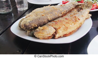 Seafood Cooked Fried Fish Trout on a Plate in a Restaurant