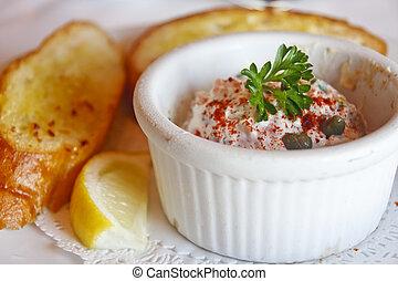Seafood Dip in ramekin with Garlic Toast - A white ramekin...