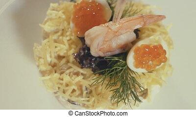 Seafood dish at the restaurant kitchen, close up - Salad...