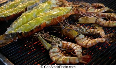 Seafood grill. Grilled shrimps on barbecue grill.