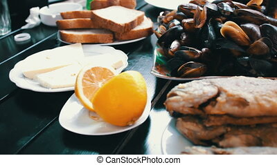 Seafood Mussels and Fish Trout on a Plate in a Restaurant....