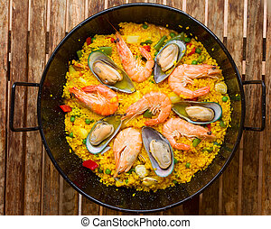 Seafood Paella in black pan -traditional spanish rice dish