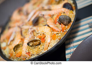 Seafood paella with mussels and shrimps